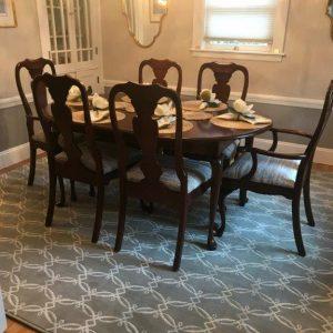 Custom cut and serged gray modern wool area rug by Nourison