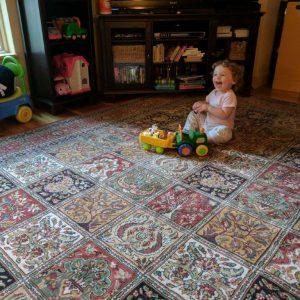 Machine made wool area rug by Momeni